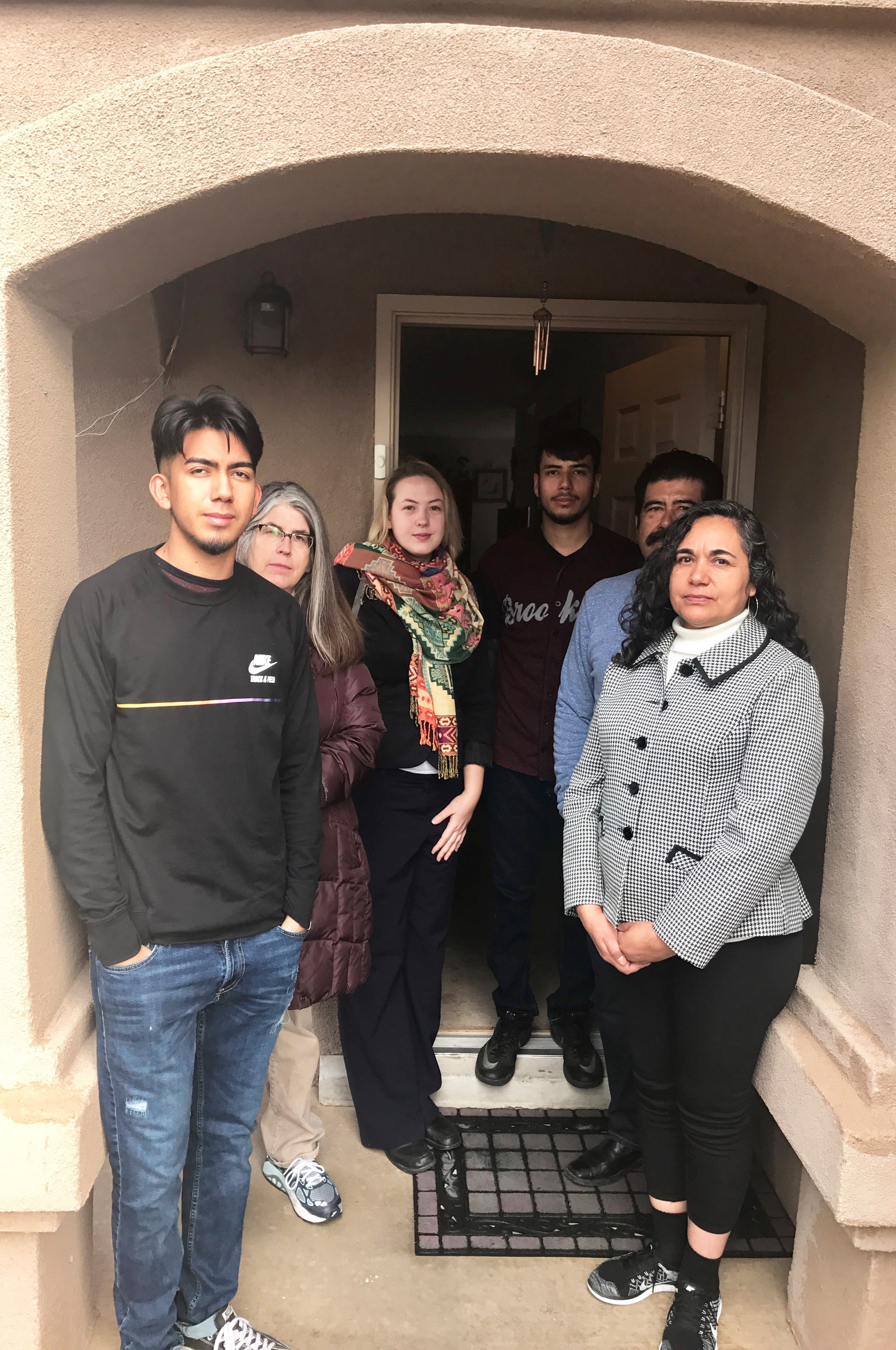 The Aguirre family at their West side home. From left: Son Josh, Tierra del Sol Housing Counselor Lisa Nichols, NMLA Attorney Mari Kempton, Son Daniel Jr., Daniel Aguirre and Aida Aguirre